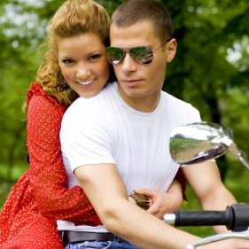Young couple riding around in the nature.